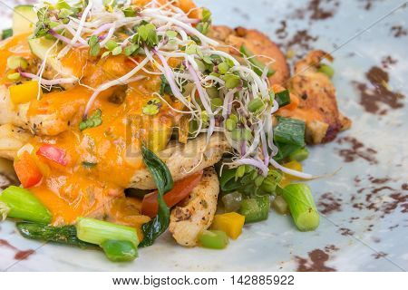 Chicken bombay with leek green pepper bean sprouts and alfalfa