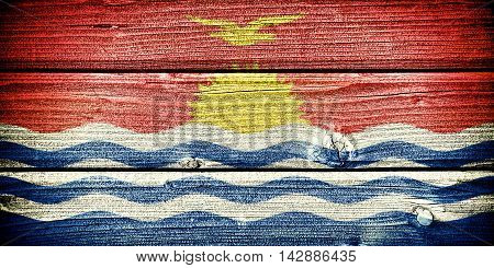Flag of Kiribati painted on old grungy wooden background: 3d illustration
