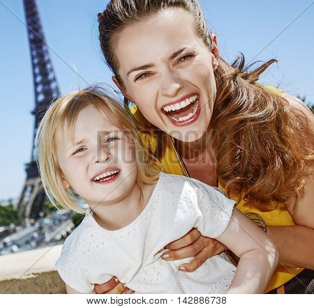 Mother And Daughter Tourists Having Fun Time In Paris, France