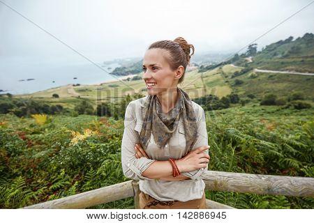 Woman Hiker Looking Aside In Front Of Ocean View Landscape