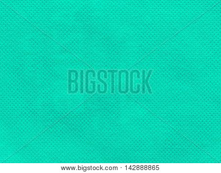 Close up of  green nonwoven fabric texture background