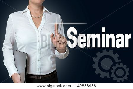 Seminar touchscreen is operated by businesswoman background