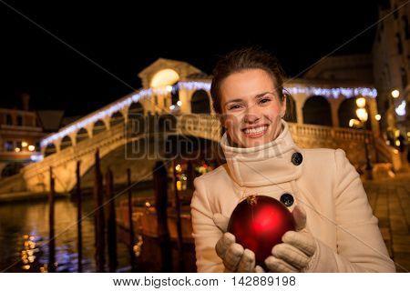Happy Woman With Christmas Ball Near Rialto Bridge In Venice