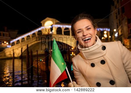 Happy Elegant Woman Spending Christmas Time In Venice, Italy