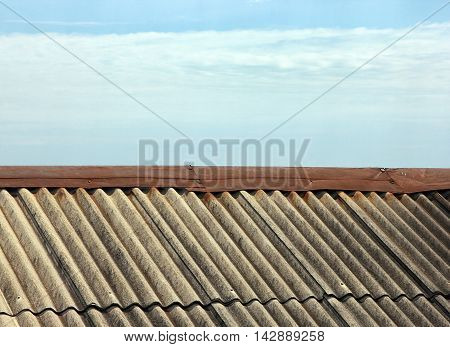 grey pitched roof slate on background blue sky