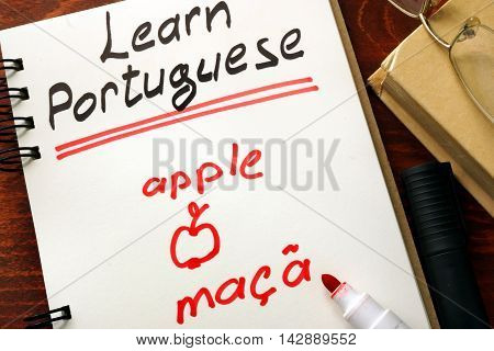 Learn portuguese written in a notepad.  Education concept.