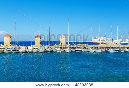 Boats in Mandraki Harbor. Rhodes Town, Rhodes Greece