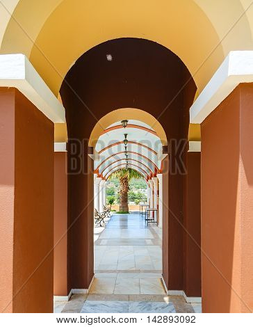 Perspective view of an arched passage in ancient monastery