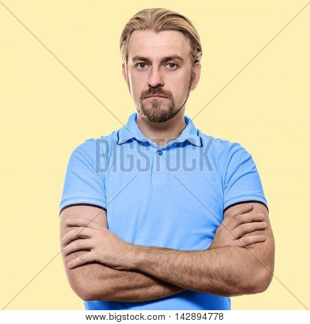Stylish Young Man Standing Arms Crossed In Blue T-shirt