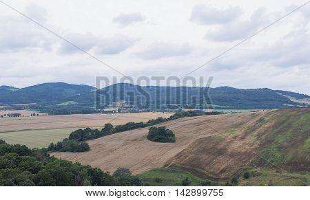 Beautiful hilly landscape with field and trees in Silesia Poland