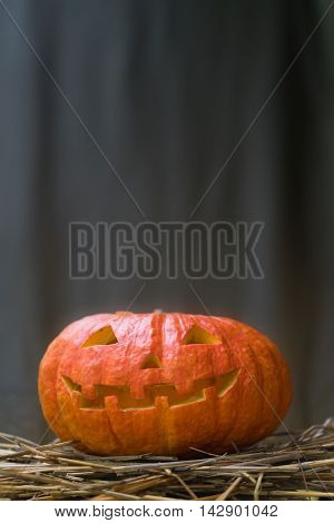 Halloween pumpkin on a gray background. Space for text.