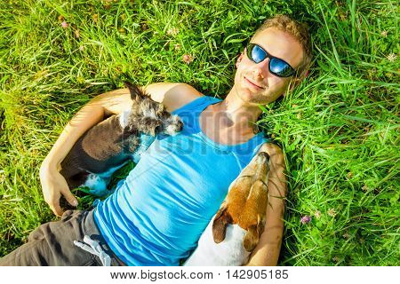 Dogs And Owner Relaxing