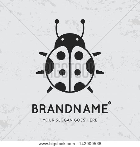Black ladybug on grunge background. Logo design vector template. Symbol concept icon.