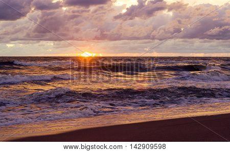 Sunset. Beautiful sunset at baltic sea. Gold sea sunset. Picture Sea sunset.