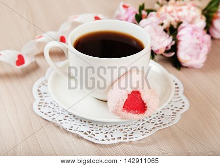 Romantic breakfast tea and dessert in the form of heart with ribbon and flower decoration