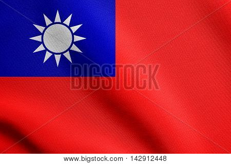 Flag of the Republic of China, ROC, Taiwan, waving in the wind with detailed fabric texture. The national flag of Taiwan.