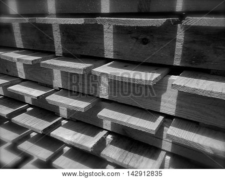 black, gray, and white grid pattern with shadows and light created by stacked boards, useful for a background