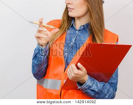 Woman Engineer Construction Builder Holds File Pad.