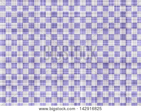 Blue and white squares on a white simple fabric.