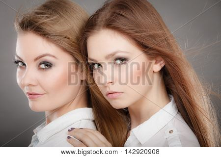 Two Beautiful Photomodels Portrait.