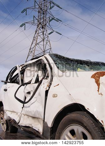 Heavily damaged car after a crash near a high voltage power pole Australia 2016