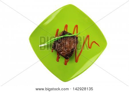 meat savory : grilled beef fillet mignon on green plate with chives and ketchup isolated over white background