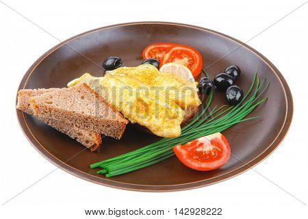 served roast golden fish fillet with tomatoes, rye bread and olives