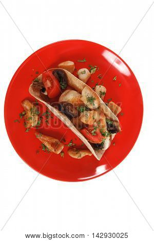 big mexican taco with tomatoes and mushroom on red plate isolated over white background