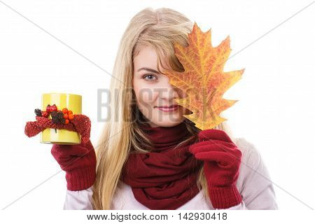 Smiling Girl In Gloves Holding Decorated Cup Of Tea And Autumnal Leaf
