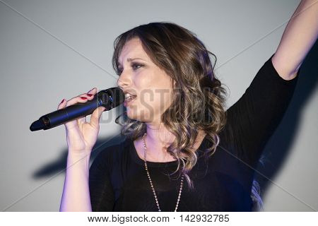 BRONX NEW YORK - SEPTEMBER 9: Female singer Christine D' Clario performs during a Christian concert for Realizing Possibilities ministry. Taken September 9 2012 in New York.