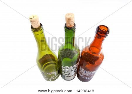 Three Dusty Wine Bottles Isolated On White