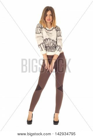 Healthy Teen In Brown Tights Stands With Hands Isolated