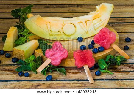 The Melon Is Carved The Word Love