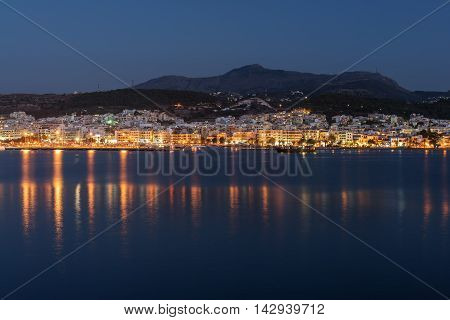 Rethymno, Crete, Greece: downtown at summer night. Panoramic view from the Mediterranean sea.