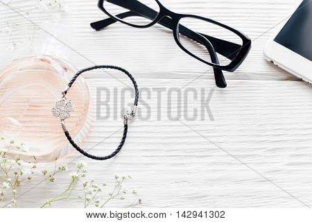 Romantic business woman table, free space. Different female accessories on white wooden background, flat lay