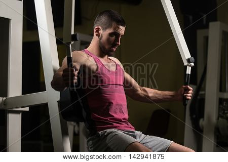 Man In The Gym Exercising Chest On Machine