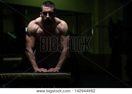 Pushups On Bench In A Dark Room