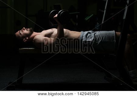 Lower Arm Exercise With Dumbbell In Gym