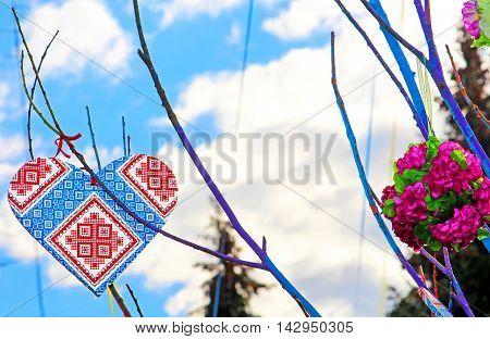 Hand made heart in the style of Ukrainian vyshyvanka on the handmade tree which children made due to Europe Day in Vinnytsia, Ukraine