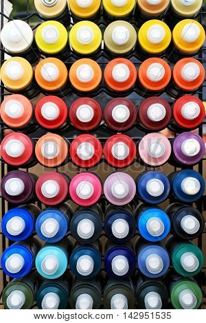 Spray cans of paint for graffiti on the wall