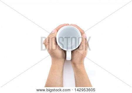 Man Holding Empty Cup Of Milk On White Table