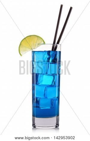 Blue curacao cocktail with lime and cherry in tall glass isolated on white background.