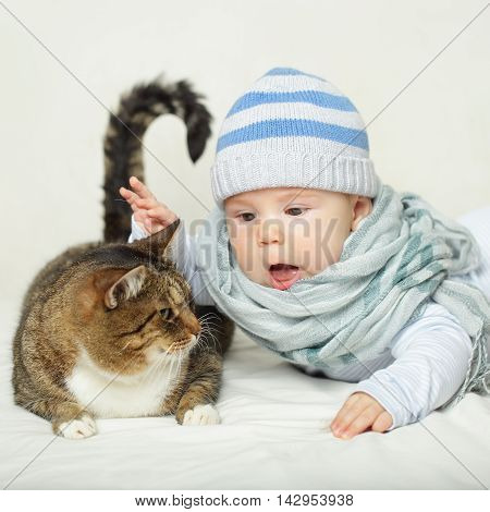 Child and cat baby playing with pet - no allergy!