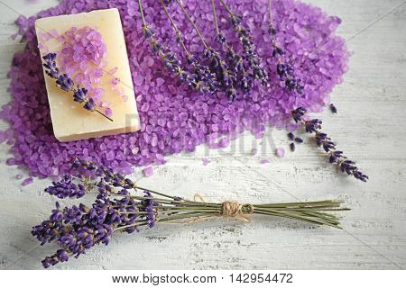 Spa composition with lavender, soap and salt on white wooden background