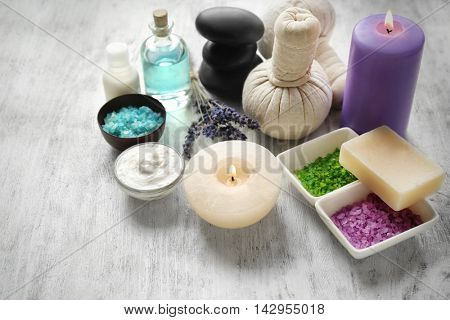 Spa composition with lavender, candles and salt on white wooden background