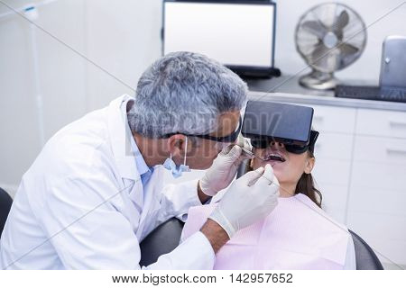 Dentist examine female patient with dental tools at dental clinic