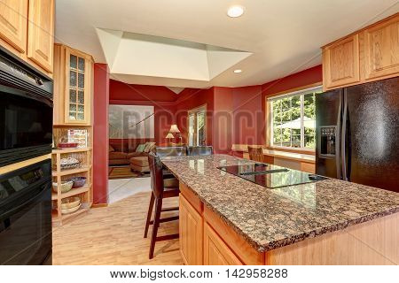 Kitchen Room Interior With Red Walls, Granite Counter Top And Bar Stand.