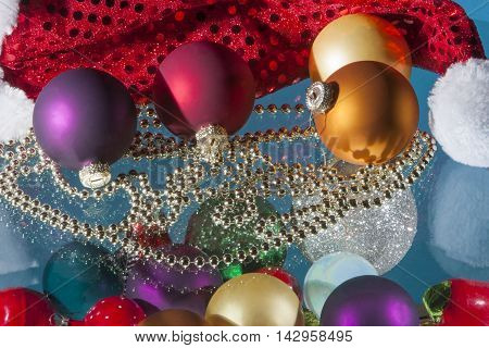 Colorful christmas balls decoration and bead chain with reflections