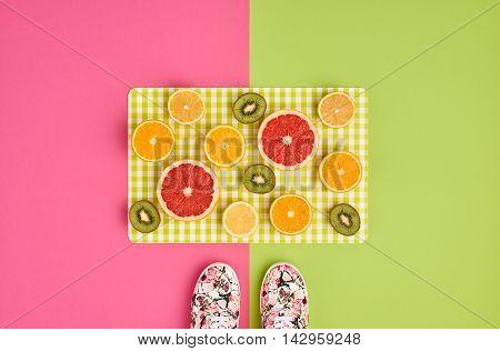 Fashion. Summer Accessories fashion set. Tropical Fruit Citrus, Orange, Grapefruit Lime Kiwi. Fashion woman Glamor Wrist Watches, Trendy Gumshoes. Stylish girl. Fashion creative concept. Minimal Art