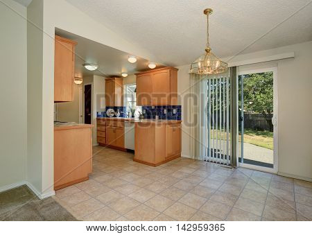 House Interior. Maple Kitchen Cabinets And Tile Floor.